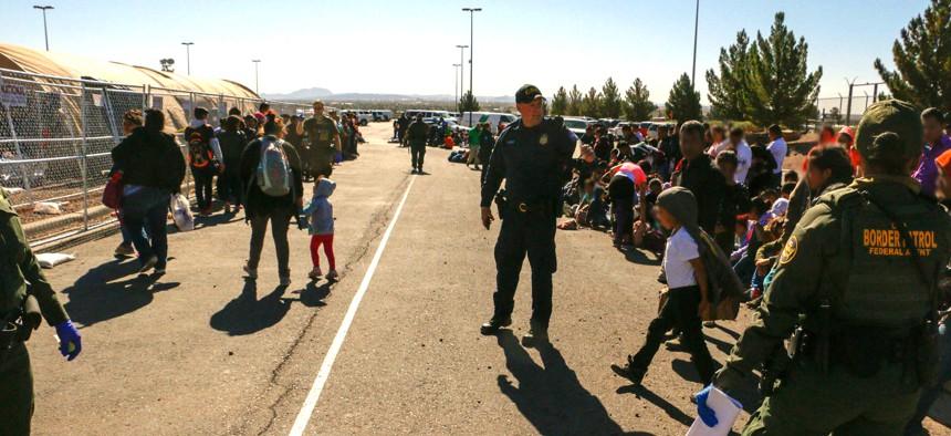 Border Patrol agents working in El Paso apprehend migrants in 2019.