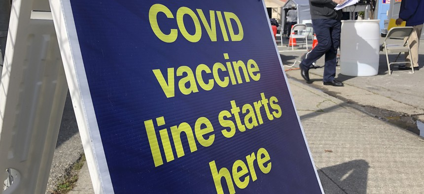 A sign is shown at a COVID-19 vaccine site in the Bayview neighborhood of San Francisco on Feb. 8.