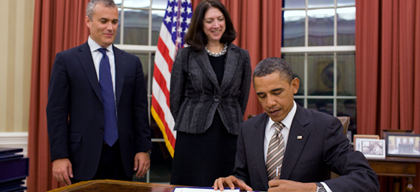 President Barack Obama signs the GPRA Modernization bill in 2011. With him is Chief Performance Officer/OMB Deputy Director for Management Jeff Zients and OMB Associate Director for Performance and Personnel Management, Shelley Metzenbaum.
