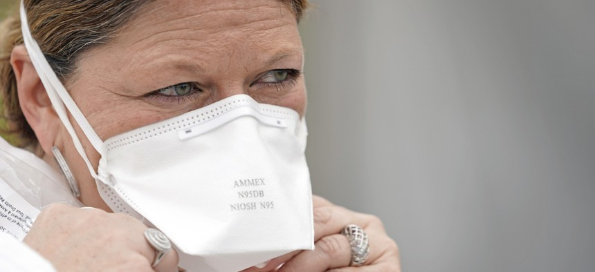 Nurse Yvette Laugere adjusts her N95 mask while working at a newly opened free COVID-19 testing site operated by United Memorial Medical Center on April 2 in Houston