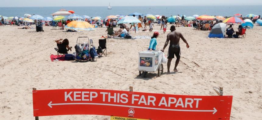 Revelers enjoy the beach at Coney Island on July 4, 2020.