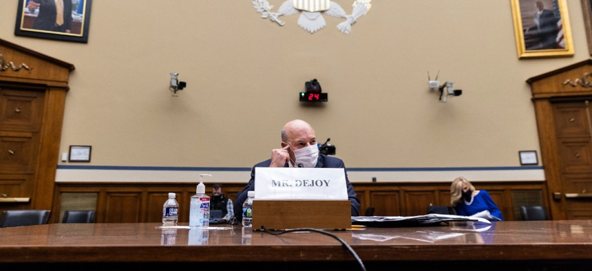 Postmaster General Louis DeJoy speaks during a House Oversight and Reform Committee hearing on Feb. 24.