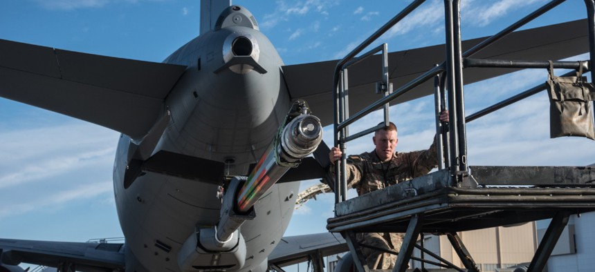 Master Sgt. Chris Hughes, 22nd Maintenance Squadron hydraulics craftsman, climbs onto a B4 stand to begin an acceptance inspection on a KC-46A Pegasus boom in February 2019 at McConnell Air Force Base, Kan.