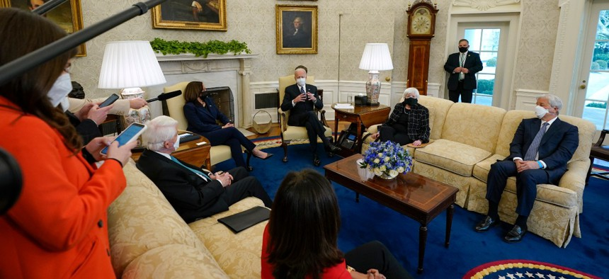 President Joe Biden, accompanied by Vice President Kamala Harris and Treasury Secretary Janet Yellen, meets with business leaders to discuss a coronavirus relief package in the Oval Office on Feb. 9.
