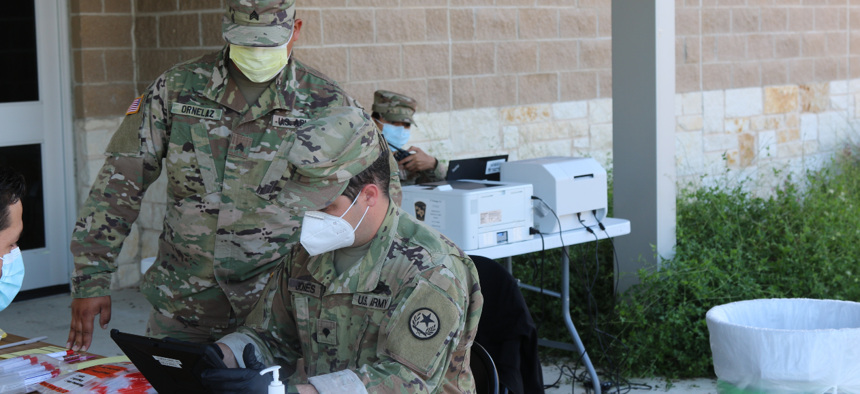 Airmen and Soldiers with the Texas National Guard perform COVID-19 testing as part of the Texas Mobile Testing Team program in Bryan, Texas.