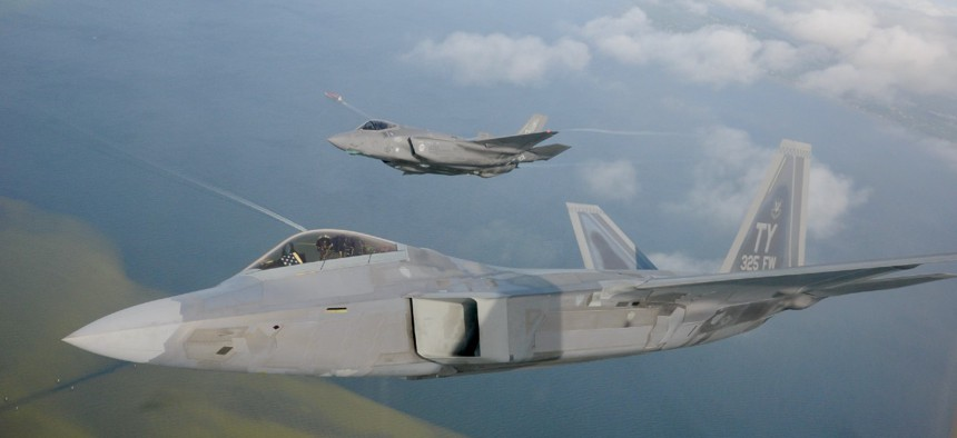 An F-22 Raptor from the 325th Fighter Wing flies alongside an F-35 Lightning II from the 33rd Fighter Wing over the Emerald Coast.