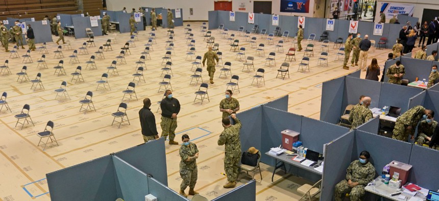 Primarily Navy personnel prepare for the opening of a mass COVID-19 vaccination site in the Queens borough of New York. This FEMA run site, along with another in Brooklyn, gives priority to local residents in an effort to equitably distribute the vaccine.