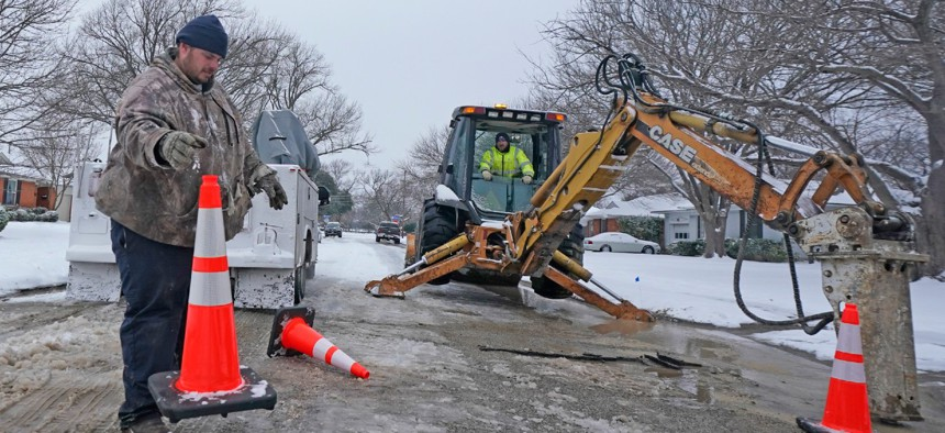 City of Richardson workers prepare to work on a water main pipe that burst due to extreme cold on Feb. 17 in Richardson, Texas.