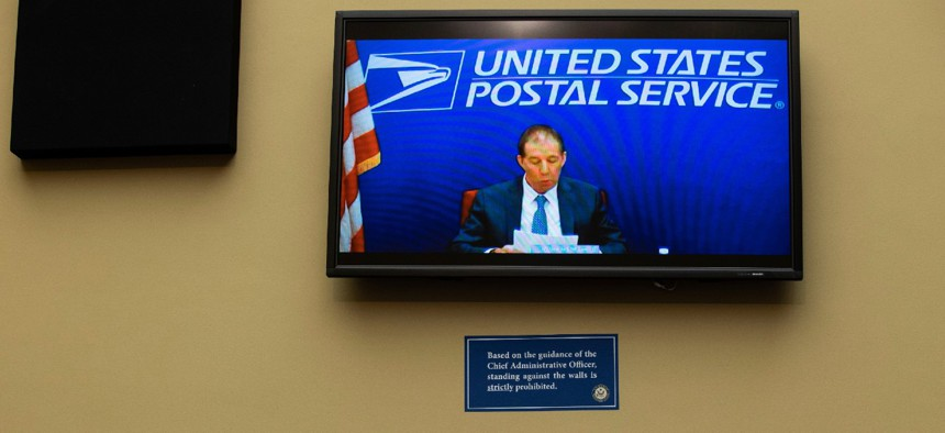 Chairman of the United States Postal Service Board of Governors Ron Bloom speaks via video conference during a February congressional hearing. Bloom is a Democrat but lawmakers are upset he has not done more to stand up to Postmaster General Louis DeJoy.