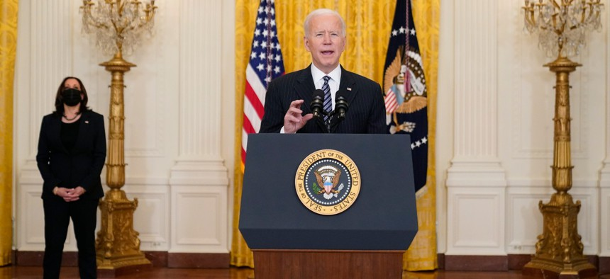 President Joe Biden speaks about COVID-19 vaccinations, from the East Room of the White House on March 18 as Vice President Kamala Harris listens.