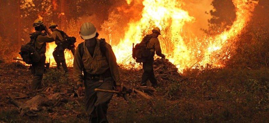 The Silver State Interagency Hotshot Crew works on a burning operation at the Rim Fire in the Stanislaus National Forest, which began on Aug. 17, 2013.