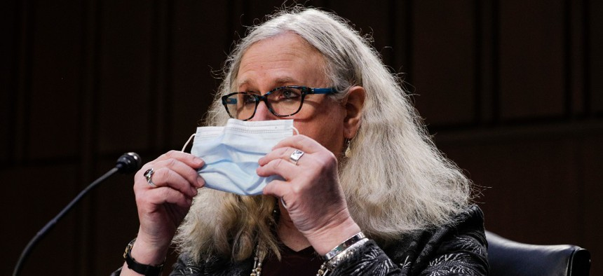 Rachel Levine, nominated to be an assistant secretary at the Department of Health and Human Services, holds her face mask as she testifies on Capitol Hill in February.