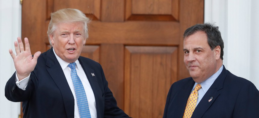 Then President-elect Donald Trump and Former New Jersey Gov. Chris Christie, Trump's transition manager at the time, speak to reporters on Nov. 20, 2016. Christie promised to root out any Obama appointees who had converted to civil service positions.