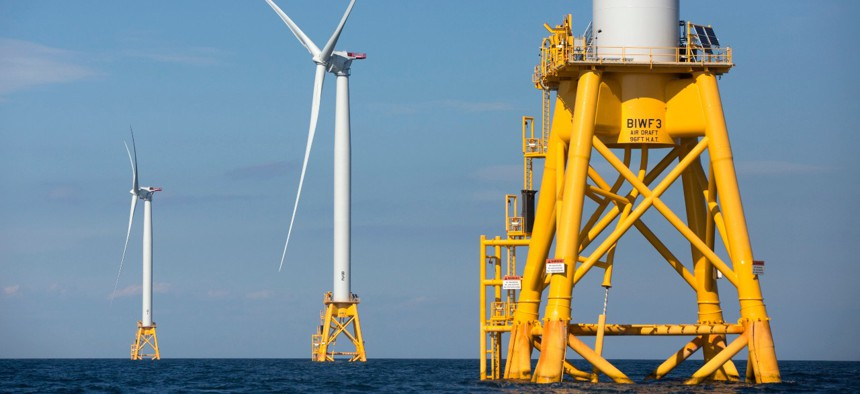 Three of Deepwater Wind's turbines stand in the water off Block Island, R.I.  in 2016