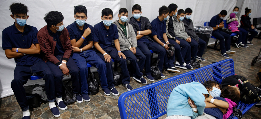 Young unaccompanied migrants wait for their turn at the secondary processing station inside the U.S. Customs and Border Protection facility in Texas on Tuesday, March 30, 2021.