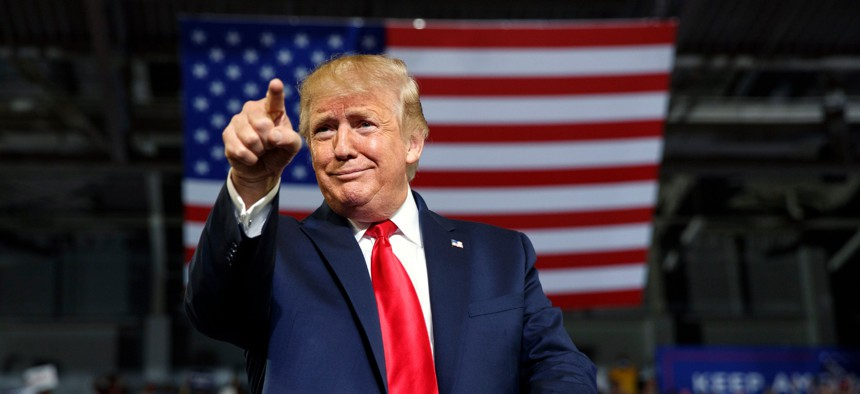 In this Wednesday, July 17, 2019 file photo, President Donald Trump gestures to the crowd as he arrives to speak at a campaign rally at Williams Arena in Greenville, N.C.