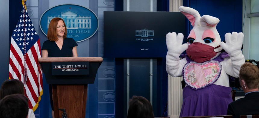 White House press secretary Jen Psaki smiles at the Easter Bunny during a press briefing at the White House on Monday.