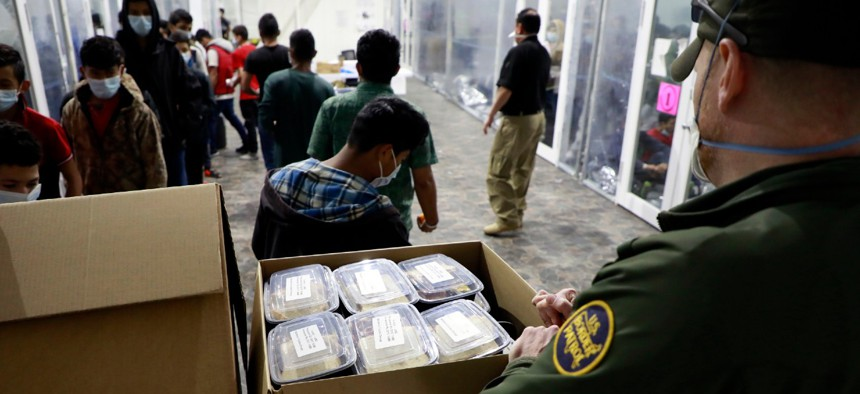 A Border Patrol agent works at a temporary processing facility in Donna, Texas, in March.