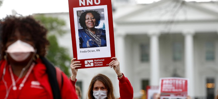 Nurses from National Nurses United protest in front of the White House on,April 21, 2020.