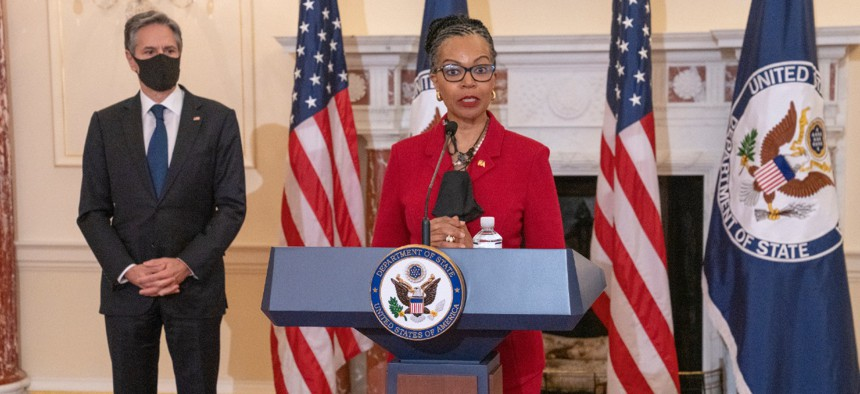 With Secretary of State Antony Blinken looking on, Amb. Gina Abercrombie-Winstanley, chief diversity and inclusion officer, delivers remarks at the State Department on April 12.