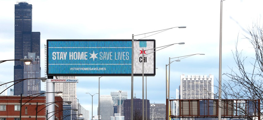 A public service message is seen on a billboard near the Dan Ryan Expressway in March 2020.