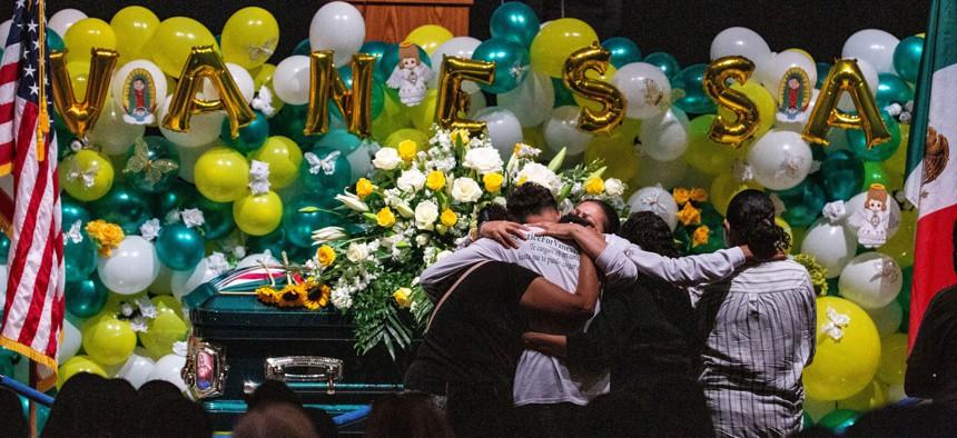 Alma Garcia embraces Juan Cruz, the boyfriend of Army Spc. Vanessa Guillen at her memorial service on Friday, Aug. 14, 2020, in Houston.