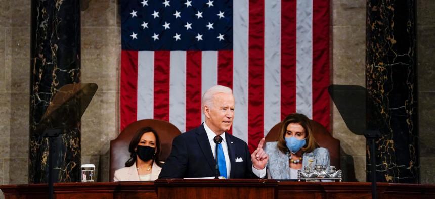 President Joe Biden addresses a joint session of Congress on April 28 as Vice President Kamala Harris, left, and House Speaker Nancy Pelosi of Calif., look on.