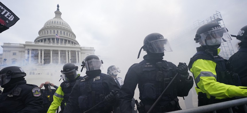 Police stand guard Jan. 6, 2021, after holding off violent rioters who tried to break through a police barrier at the Capitol in Washington.