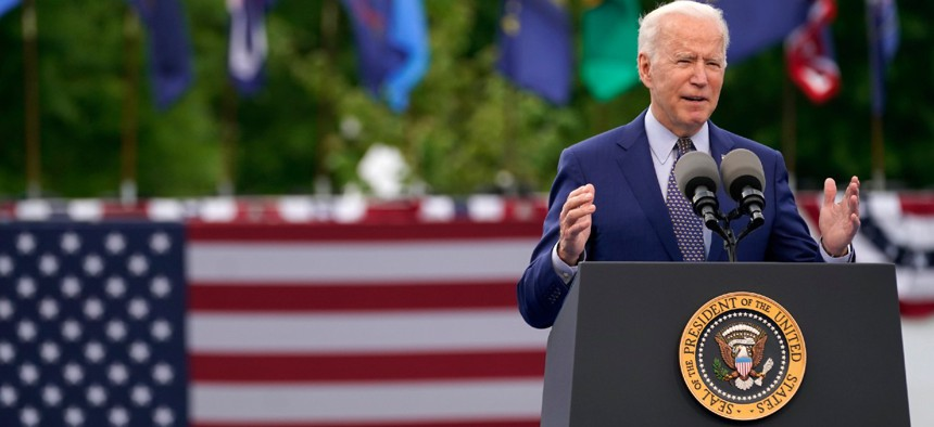 President Biden speaks during a rally Thursday in Duluth, Ga. to mark his 100th day in office.