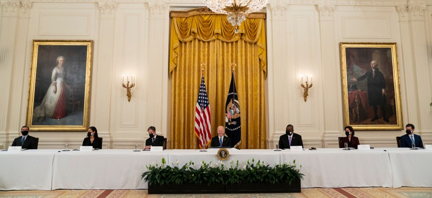 President Joe Biden speaks during a Cabinet meeting in the East Room with, from left, Health and Human Services Secretary Xavier Becerra, Interior Secretary Deb Haaland, Secretary of State Antony Blinken, Biden, Secretary of Defense Lloyd Austin, Commerce Secretary Gina Raimondo, and Transportation Secretary Pete Buttigieg.