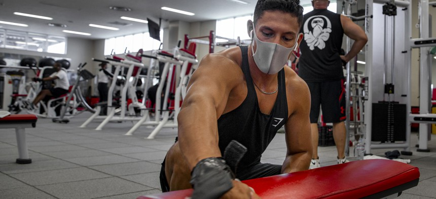 Marine Cpl. Avery Luengo wipes downs gym on Camp Foster, in Okinawa, Japan, July 29, 2020.