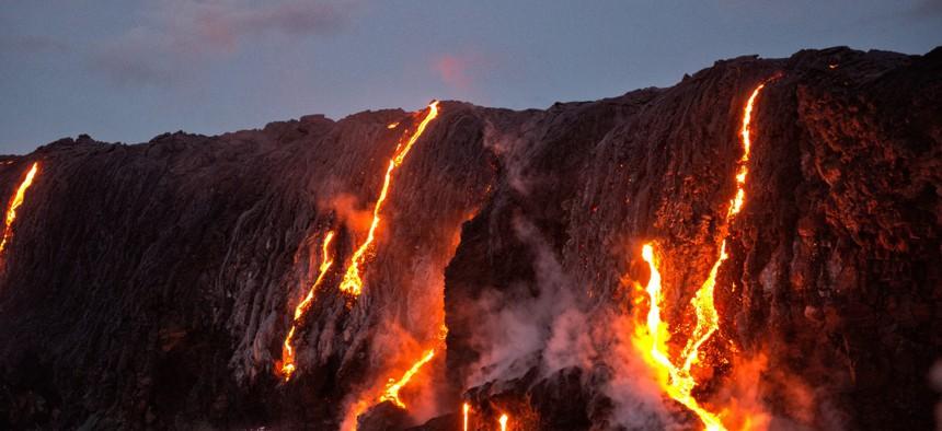 Lava from Kilauea volcano entering ocean, Big Island, Hawaii.