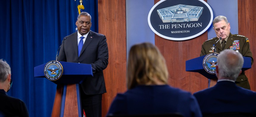 Defense Secretary Lloyd Austin and Chairman of the Joint Chiefs of Staff Army Gen. Mark Milley speak to press during a briefing at the Pentagon, May 6, 2021.