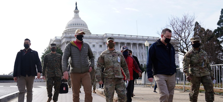 Acting Secretary of Defense Christopher Miller (third from left) walks with members of the National Guard outside the U.S. Capitol on January 17, 2021, in Washington, DC.