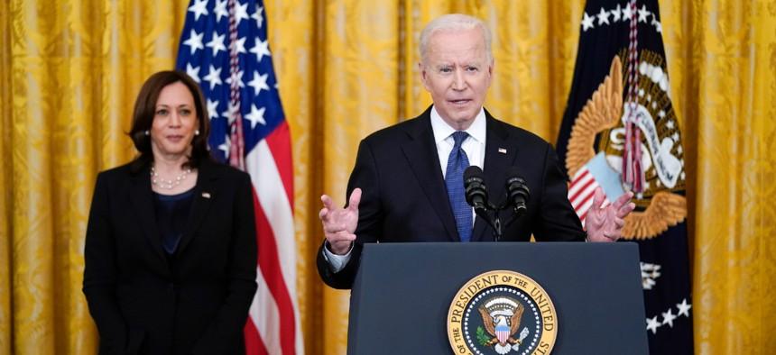 President Biden speaks before signing the COVID-19 Hate Crimes Act on Thursday as Vice President Kamala Harris looks on.