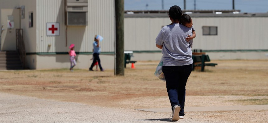 Immigrants seeking asylum walk at the ICE South Texas Family Residential Center in August 2019.
