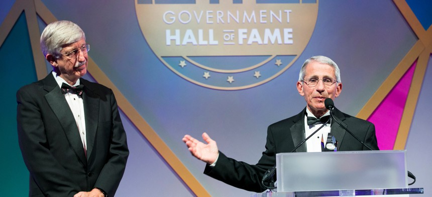 Dr. Anthony Fauci accepts his induction into the Government Hall of Fame in 2019 alongside NIH director Francis Collins.