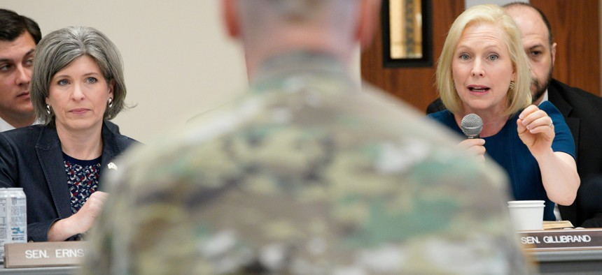 Sen. Kirsten Gillibrand, D-N.Y., right, directs a question to Maj. Gen. Scott Spellmon, deputy commanding general, civil and emergency operations of the U.S. Army Corps of Engineers, center, as Sen. Joni Ernst, R-Iowa, left, listens in 2019.