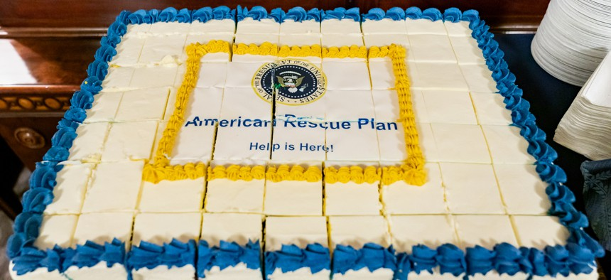 A cake is cut and ready to serve in the West Wing Lobby of the White House on Friday, March 12, 2021, to celebrate the signing of the American Rescue Plan.