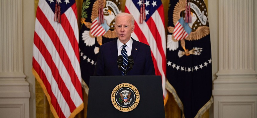 US President Joe Biden speaks during his first press briefing in the East Room of the White House in Washington, DC, on March 25, 2021.