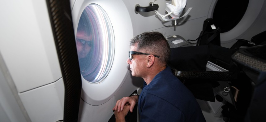 NASA astronaut and SpaceX Crew-2 Commander Shane Kimbrough, looks out the Crew Dragon Endeavour's window during its trip to the International Space Station.