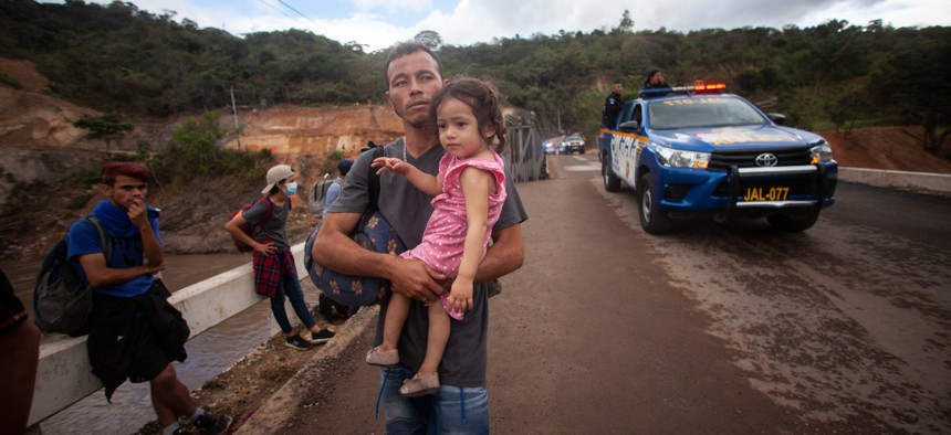 Migrants hoping to reach the distant U.S. border walk along a highway in Guatemala in January 2021.
