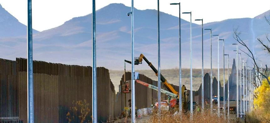 Crews construct a section of border wall in San Bernardino National Wildlife Refuge in Douglas, Ariz., in December 2020.