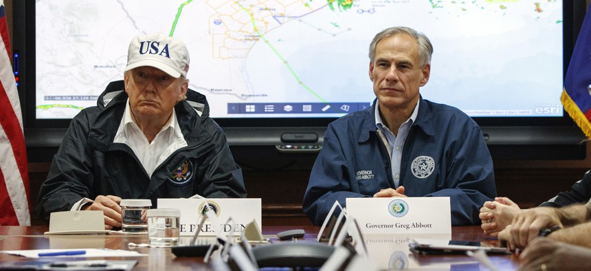 President Donald Trump, accompanied by Texas Gov. Greg Abbott, speaks during a briefing on Hurricane Harvey relief efforts at the the Texas Department of Public Safety Emergency Operations Center in Austin in 2018.
