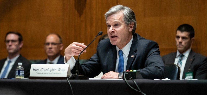 FBI Director Christopher Wray testifies before the Senate Appropriations Subcommittee on Commerce, Justice, Science, and Related Agencies on Wednesday.