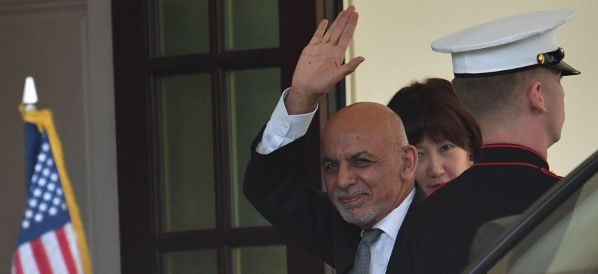 Afghan President Ashraf Ghani waves as he arrives to the White House to meet with US President Joe Biden in Washington, DC, on June 25, 2021.
