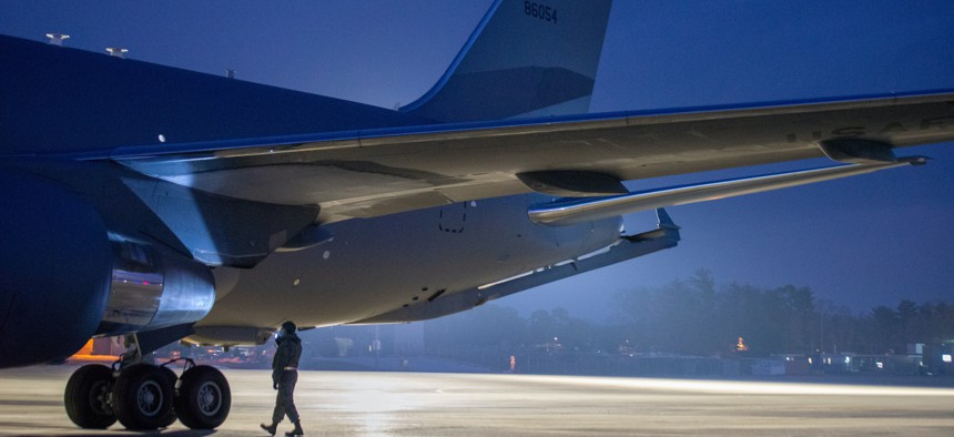A New Hampshire Air National Guard airman inspects a KC-46 after it was delivered to Pease Air National Guard Base, New Hampshire, Dec. 11, 2020.