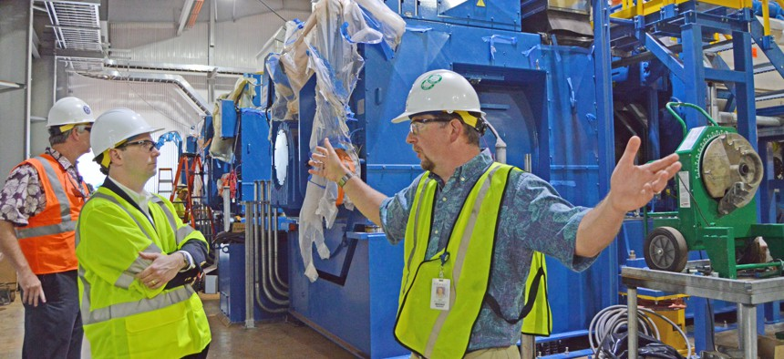 Hawaiian Electric Co. Manager of Generation Project Development Jack Shriver gives a tour of the Schofield Barracks Generating Station in 2018.