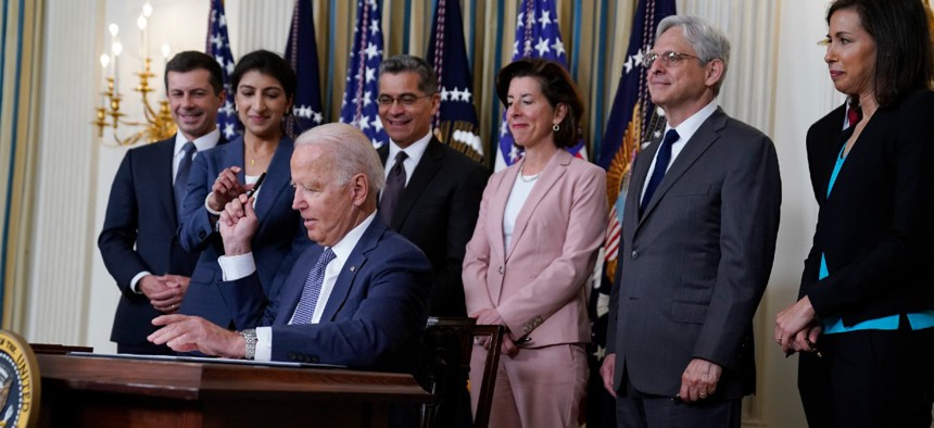 President Biden signs an executive order aimed at promoting competition in the economy in the State Dining Room of the White House on July 9.