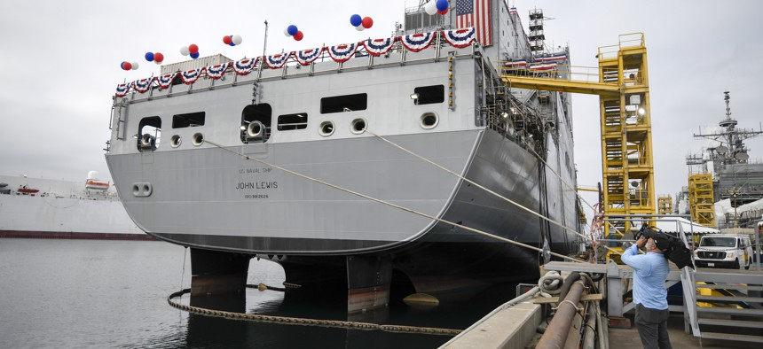 A television cameraman videotapes the USNS John Lewis before a christening ceremony on July 17, 2021, in San Diego.